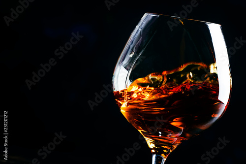 Cognac in a glass, dark background, selective focus