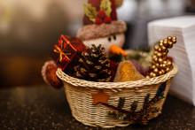 Christmas Home Decor With Pine Cones, Fruit, And A Snowman