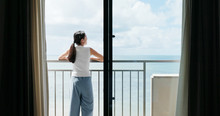 Woman Look At The Sea In Balcony