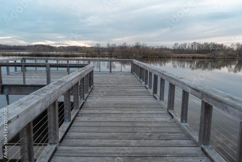 Photo Wood fishing dock over Purgatory Creek at sunset in Autumn