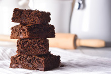 Closeup Of A Plate Of Fresh Homemade Brownies On A White Towel
