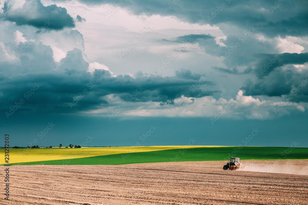 Fototapeta Tractor Plowing Field In Spring Season. Beginning Of Agricultura