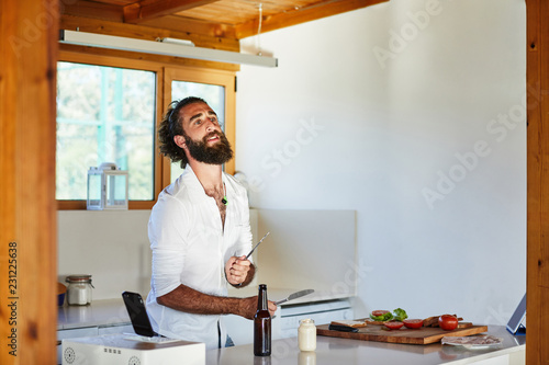 Man listening to music in kitchen
