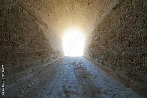 Papiers peints Tunnel Inside a tunnel with bright light at the end, natural scene, L'Ametlla de Mar, Tarragona, Catalonia, Spain