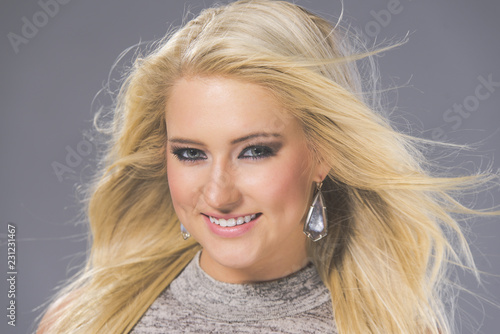 Beauty Head Shot of a Gorgeous Blonde Woman with Hair Movement