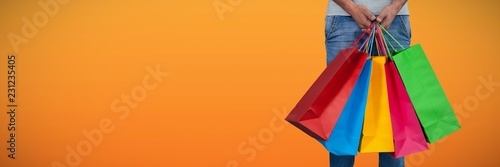 Fotomural Composite image of low section of man carrying colorful shopping