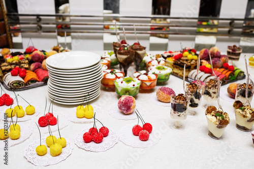 Aluminium Prints Modern desserts, cupcakes, sweets with fruits. Delicious candy bar. Catering Concept.