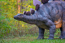 Big Model Of Prehistoric Dinosaur In Nature. Realistic Scenery.