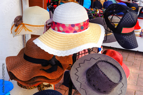 Men s and women s hats in retro vintage style on sale in the market ... 7a4492a01a8