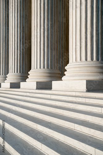 Obraz na płótnie Abstract close-up of the neoclassical white marble fluted columns with steps at