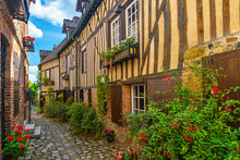 Old Cozy Street With Historic Half Timbered Buildings In The The Beautiful Town Of Honfleur, France