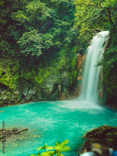 Fototapeten Wasserfalle Waterfall in tropical forest, blue water.