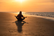 Meditating at sunrise on the beach at St Simons Island, GA