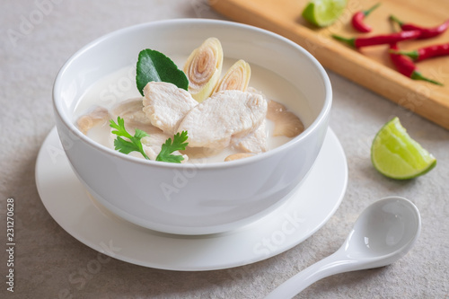 Chicken with coconut milk soup in white bowl, Thai food (Tom Kha Kai).