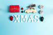 Word XMAS and Christmas decorations with space for text on blue background. Word XMAS and Christmas decorations with space for text on blue background.