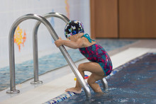Child Entering The Swimming Pool