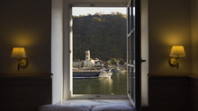 View From Hotel Window On The Rhine As A Cruise Boat Travels Past.