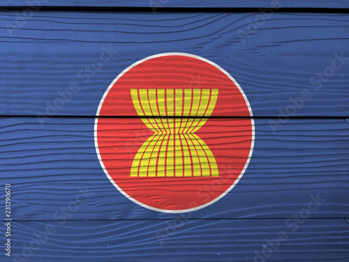 Foto  Flag of Asean on wooden wall background