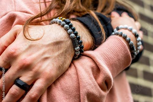 Men's bracelets on hand Fototapete