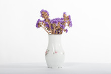 Purple Dried Plant In A White Vase