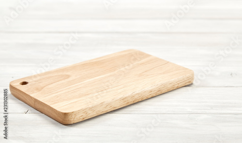 Photographie Cutting board top view on wooden background
