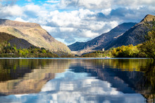 Reflections At Llyn Padarn With Dolbadarn Castle At Llanberis In Snowdonia National Park In Background - Wales