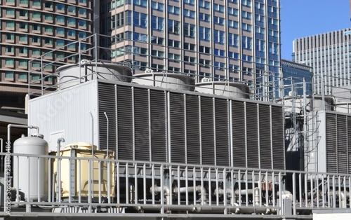 Fotomural Cooling tower for HVAC system with coils and fins on display with backdrop on ci