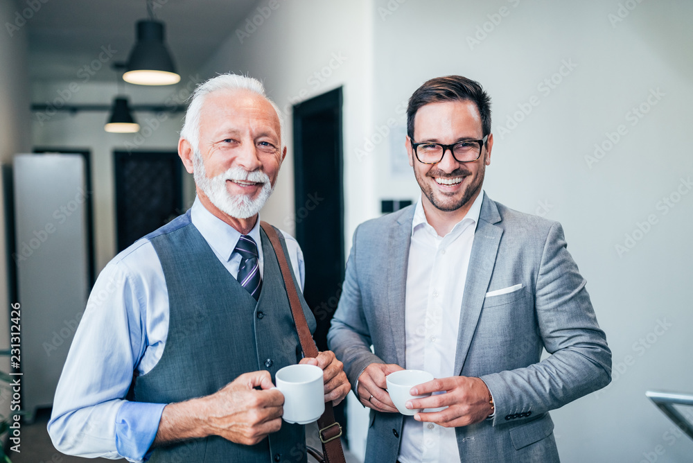 Fototapety, obrazy: Portrait of two successful smiling business men.