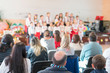 Children's holiday in kindergarten. Children on stage perform in front of parents. image of blur kid 's show on stage at school , for background usage. Blurry