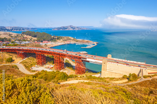 Tuinposter Amerikaanse Plekken Aerial view from top of Golden Gate Bridge, north shore, Mill Valley, San Francisco Bay, California. American travel concept. Blue sky.