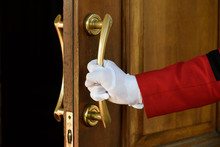 The Doorman Opens The Hotel Do...