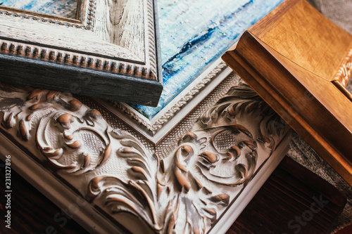 Decorative classic picture frames. Wooden frames background.