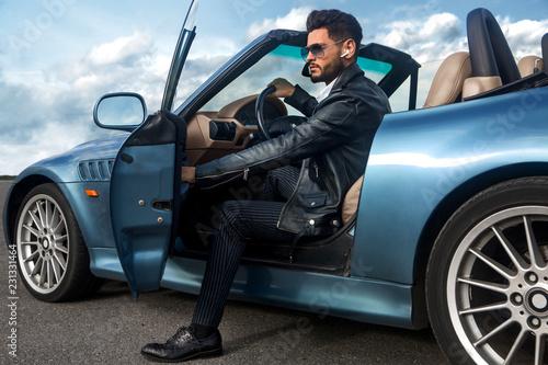 Obraz Handsome man near the car. Businessman. - fototapety do salonu