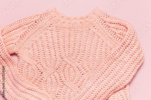 Garden Poster Female pink knitted sweater pullover on pastel pink background top view flat lay. Fashion Lady Clothes Set Trendy Cozy Knit Jumper Autumn winter clothes Female fashion look Lifestyle gentle background