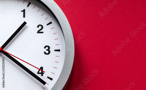 clock face on red background Canvas Print