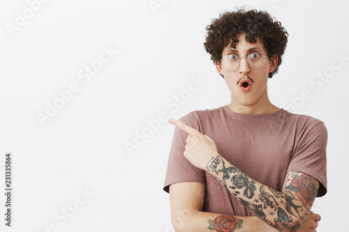 Fotografie, Tablou  Waist-up shot of excited and impressed emotive attractive male student with styl