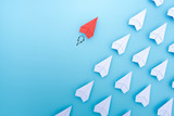 Red paper plane are different from others on blue background. Think different. Business for innovative, solution concepts.