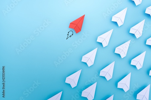 Obraz Red paper plane are different from others on blue background. Think different. Business for innovative, solution concepts. - fototapety do salonu