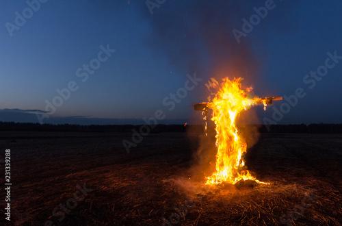 Fotografiet  burning cross in the night