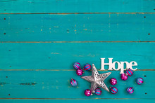The Word Hope Hanging On Antique Rustic Teal Blue Wooden Background With Colorful Turquoise And Pink Christmas Ornaments And Silver Star;  Religious Holiday And Spiritual Wood Sign With Copy Space