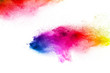 Abstract colorful dust particles textured background.Multicolored particles explosion on white background.