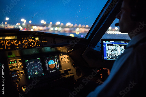 Fotografie, Obraz  Commercial airliner airplane flight cockpit during takeoff