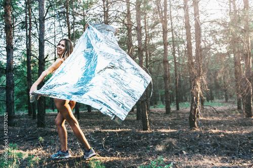 Fotografie, Obraz  Beautiful girl is wrapped in a foil emergence blanket