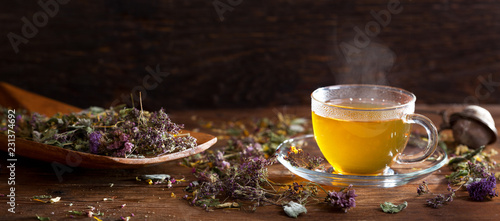 Foto op Plexiglas Thee Cup of herbal tea with various herbs