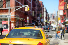 Yellow Taxi Cabs And People Rushing On Busy Streets Of Downtown Manhattan.