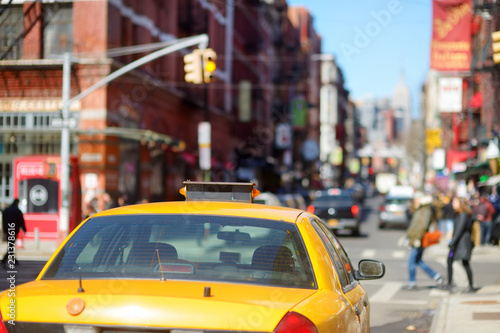 Poster New York TAXI Yellow taxi cabs and people rushing on busy streets of downtown Manhattan.