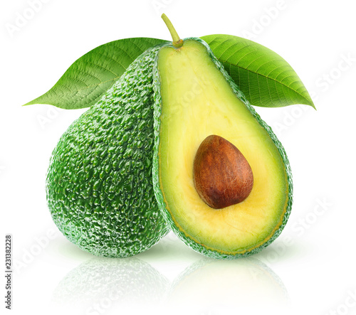 Isolated avocados. Two avocado fruits, one cut in half, on a branch with leaves isolated on white background with clipping path