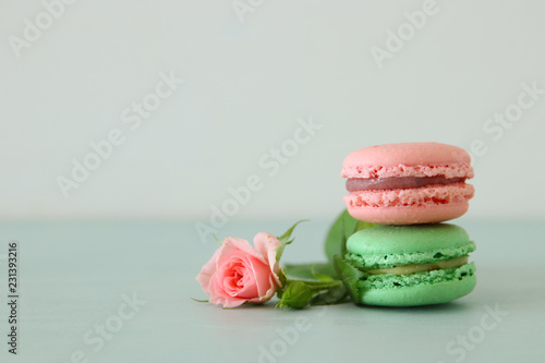 Image of romantic colorful macaron or macaroon over pastel background.