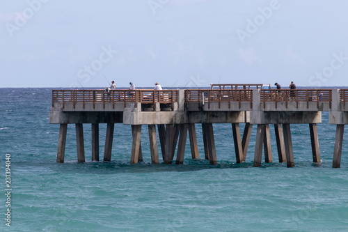 fishing pier with people fishing
