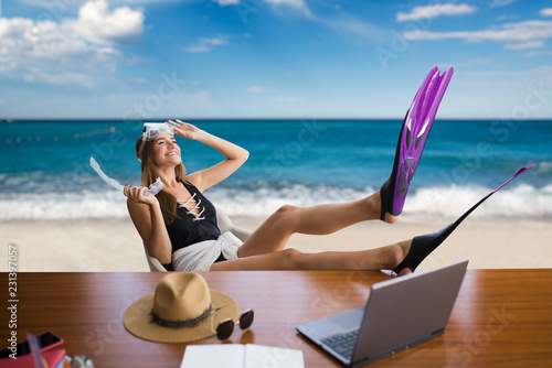 Woman in flippers at table, dreams about vacation